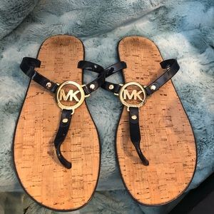 Navy sandals by Michael Kors